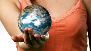 stock-footage-woman-holding-a-globe-in-her-hand